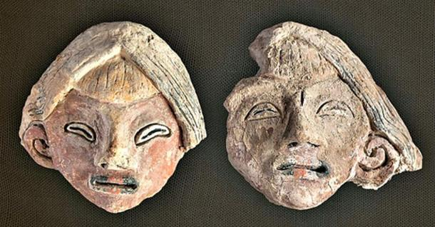 The two female heads modeled in unbaked clay.