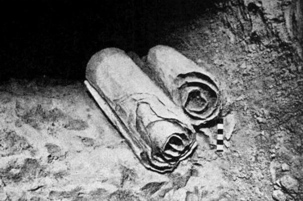 Two scrolls from the Dead Sea Scrolls lie at their location in the Qumran Caves before being removed for scholarly examination by archaeologists