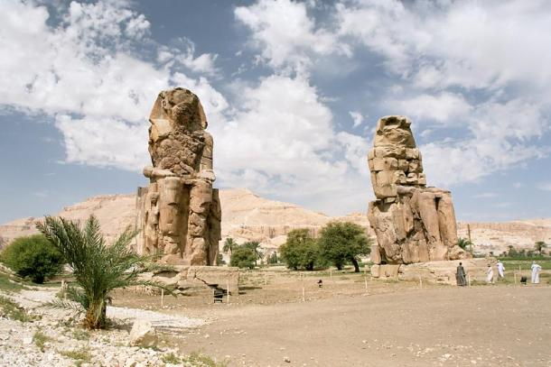 Two statues of Amenhotep III (Memnon's pillars) at the entrance to his temple (CC by SA 2.5)