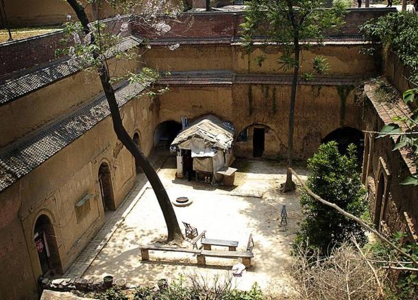A typical sunken courtyard complex, or pit dwelling in Shaanxi or Henan. The inhabitants live in the caves due to their practicality.