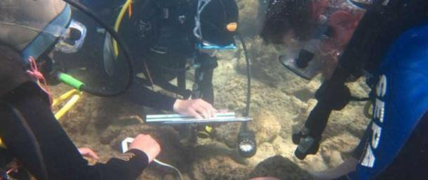 Haifa University underwater archaeologists exploring the seabed at Tel Dor.