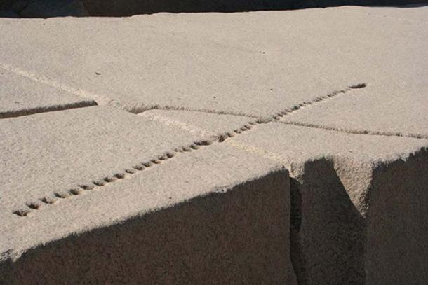 An unfinished Egyptian obelisk at Aswan with holes showing how the granite would be split.