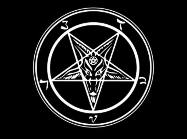 The satanic symbol of an upside-down pentagram with Baphomet in the center