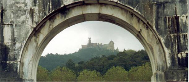 A view of Pena Palace seen through the arch of the Seteais Palace.