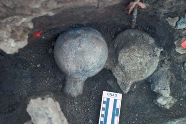A view of two mastodon femur balls, one face-up and one face-down. Neural spine of a vertebra exposed (lower right) and a broken rib (lower left). The fact that some bones were broken and others weren't may be further evidence that early humans were picking and choosing which ones to crush with hammers.