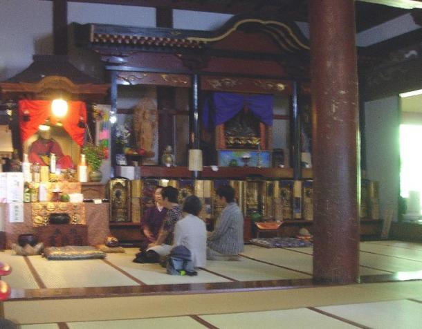 Some visitors sit in front of Tetsumonkai, Churen Temple, Japan.