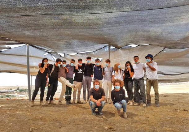A few of the volunteers that worked at the excavation site of the oldest soap factory in the world in Rahat, Israel (Emil Aladjem/Israel Antiquities Authority)