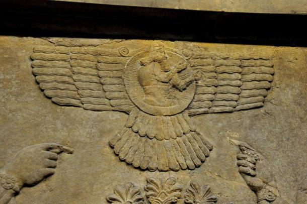 A close-up view of a wall relief depicting the God Ashur (Assur) inside a winged- disc, Nimrud, Iraq.