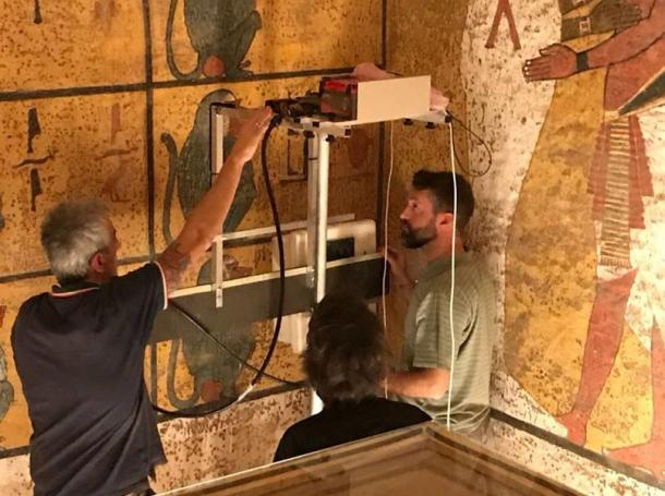 Researchers scanning the walls of King Tutankhamun's burial chamber using Ground Penetrating Radar (GPR) equipment.
