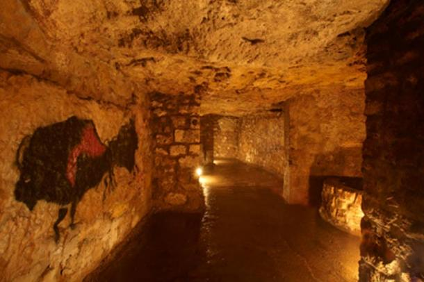Prehistoric-style art decorates the walls of the labyrinth.