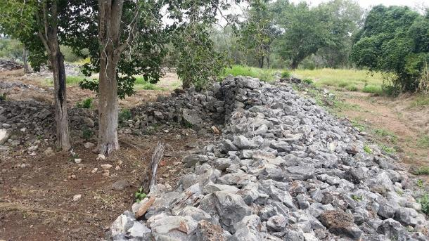 Most of the walls at the site are now reduced to piles of shaped rocks. (Image: R Fergusson)