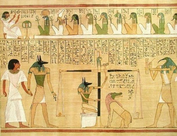 """The """"weighing of the heart,"""" from the book of the dead of Hunefer. Anubis is portrayed as both guiding the deceased forward and manipulating the scales, under the scrutiny of the ibis-headed Thoth."""