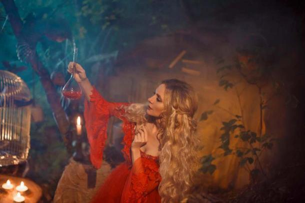 A witch creating a love potion. (kharchenkoirina /Adobe Stock)
