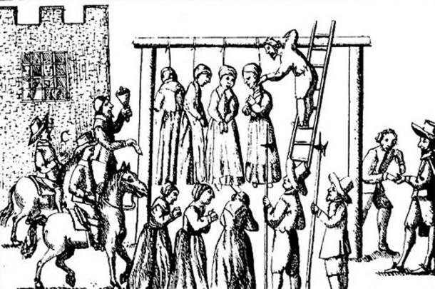 An image of suspected witches being hanged in England.