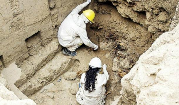 Archaeologists working in the grave sites.