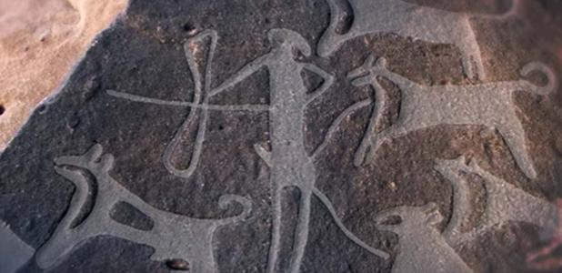 Image showing part of the engraving found in the Arabian Desert with dogs on leashes