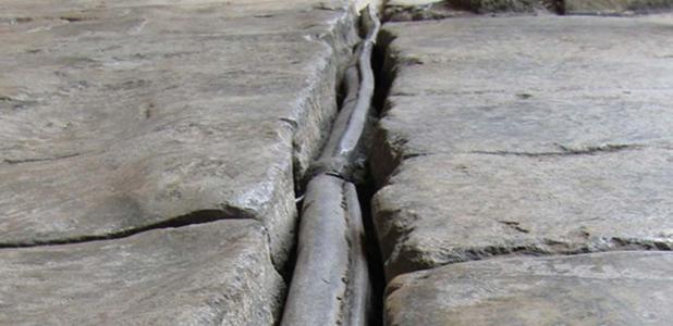 An original Roman lead waterpipe in Bath, England.
