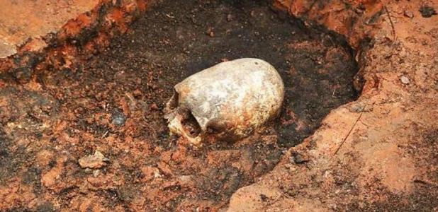Elongated skull being unearthed, Arkaim, Russia