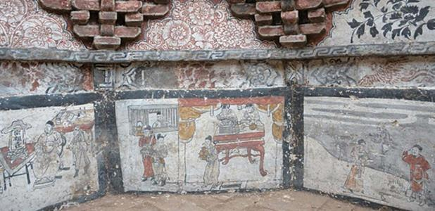 The octagon-shaped tomb is filled with murals and has a pyramid-shaped roof.
