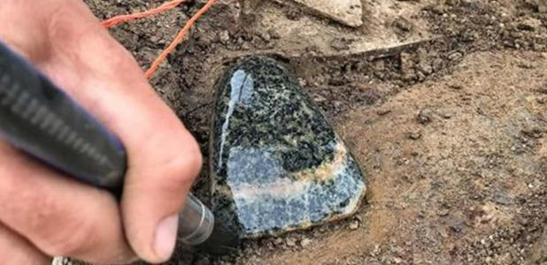 Gneiss stone axe found on the shores of Loch of Stenness.