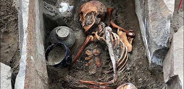 The ancient woman was buried wearing a silk skirt with a funeral meal.