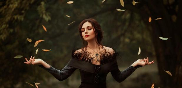 Women shaman of Ireland in trance - magic rotates the leaves.