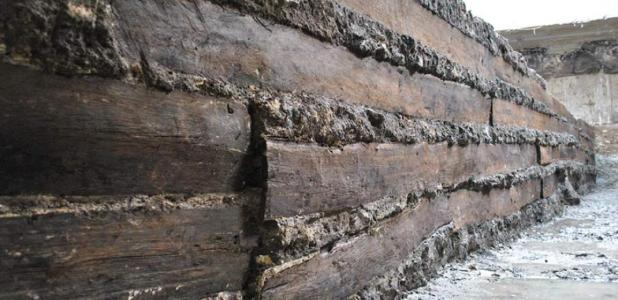 Some of the oak planks unearthed in the foundations of the portico. These planks are an example of those used for building Rome.      Source: Soprintendenza Speciale Archeologia, Belle Arti e Paesaggio di Roma, Italy