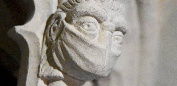 A figure wearing a face mask in St Albans Cathedral