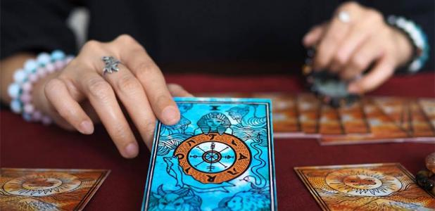Tarot card reading. Credit: Benjavisa Ruangvaree / Adobe Stock