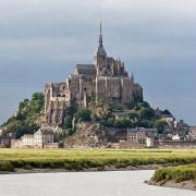Mont Saint-Michel as viewed along the Couesnon River in Normandy, France. (Public Domain)