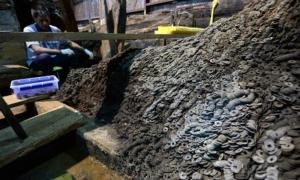 Archaeologists found 10 tons of bronze coins in and around the tomb of a dethroned Chinese emperor of the first century BC.