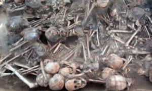 The nearly 100 skeletal remains, some charred, were found in the ruins of a tiny, 5,000-year-old house. They are believed to have been victims of a pestilence.