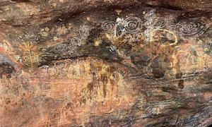 The Aboriginal rock art of Uluru that has been damaged, with stains of a dark fluid that can clearly be seen.    Source: Emma Haskin / ABC