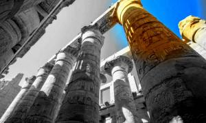 Enormous columns in the Great Hypostyle Hall at Karnak Temple complex, modern-day Luxor; design by Anand Balaji