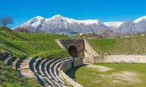 Alba Fucens, Roman archaeological site with amphitheater. Monte Velino mountain with snow, Abruzzo region, central Italy   Source: ValerioMei / Adobe Stock