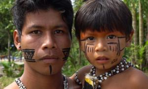 Indigenous father and son of the Amazon. Credit: gustavofrazao / Adobe Stock