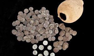 The Roman silver coins that were recently discovered in Ampurias, Spain and the amphora in which they were held.
