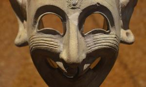 Detail of a Phoenician grinning mask, 4th century BC, found in a grave at San Sperate, Cagliari, Museo Archeologico Nazionale.