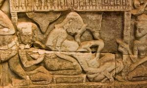 Ancient Khmer carving of childbirth.