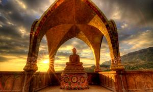 Sunset behind Buddha Image at Wat Phasornkaew