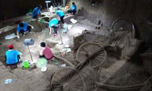 Archaeologists excavate the Zheng State No. 3 pit in Xinzheng city, Central China's Henan province, on July 12. (Image credit: VCG)