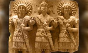 Palmyrean triad: Baalshamin, master of the skies, the Moon-god Aglibol and the Sun-god Malakbel (Yarhibol). Cultual relief, limestone, first half of the 1st century AD, found in one of the routes to Palmyra. The stele bears religious inscriptions carved by passers-by.