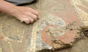 The site is being carefully excavated before the mosaics are removed.