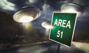 Area 51 sign on a road with dramatic lighting. Source: fergregory /Adobe Stock