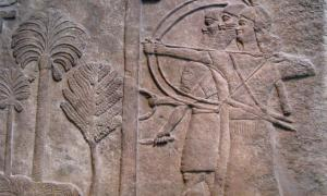 Relief, circa 728 B.C., depicting an Assyrian warrior holding a large shield to protect two archers taking aim, from the Central Palace in Nimrud and now in the British Museum, London.
