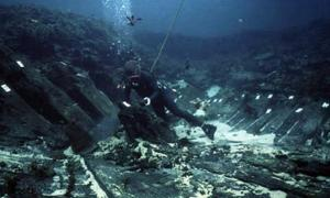 Underwater timbers related to the Batavia shipwreck being tagged by researchers off the coast of Western Australia.