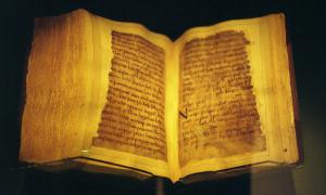 The codex, opened to a page of Beowulf