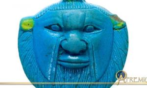 Faience amulet of the head of Bes from the Late Period, 26th to 30th Dynasties. The deity was worshipped and invoked by ordinary Egyptians as a protector against malevolent forces; design by Anand Balaji ( Metropolitan Museum of Art, New York. Deriv)