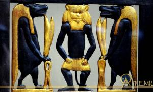 Detail from the richly decorated wooden chair or 'throne' of Sitamun, daughter and later wife of Amenhotep III, which was found in KV46. The image shows richly gilded images of Bes and two Tawaret figures; design by Anand Balaji