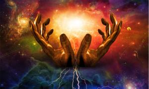 Big Bang and the hands of God representation.  Source: rolffimages / Adobe Stock